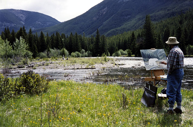 Artist Dan DAmico painting in the Beartooth Mountains, Montana.