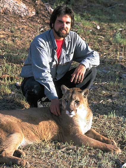 Artist Dan DAmico with one of his models, a cougar.